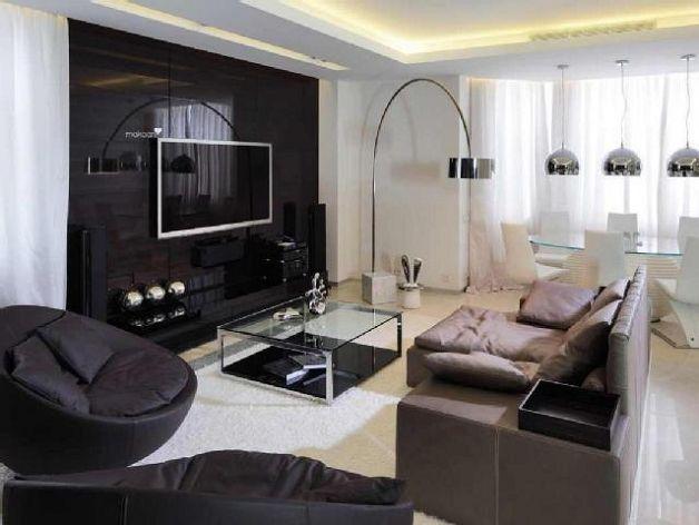 Зонированный вариант оформления гостиной и эркера